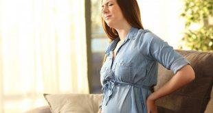 صورة الام الظهر عند الحامل في الشهور الاولى , شرح سبب الالم و الوقايه منه