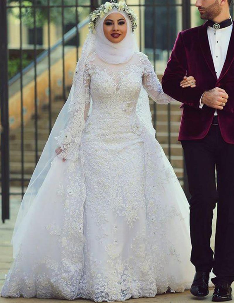 صورة اجمل فساتين الزفاف للمحجبات , عروسة وبتدوري علي فستان فرحك معانا 885 8